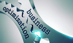 Business Optimization on Gears Mechanism on a Gray Background.-1